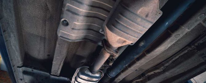 Catalytic converter on vintage vehicle. Old parts require car repair concept.
